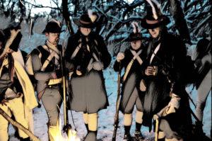 re-enactors around the campfire